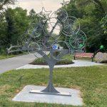 """Freewheelin"" sculpture honors retired greenways coordinator"
